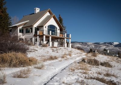 lodge at the top of a snowy mountain